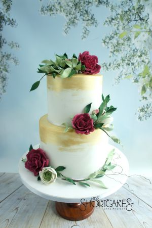 Wild roses and foliage wedding cake