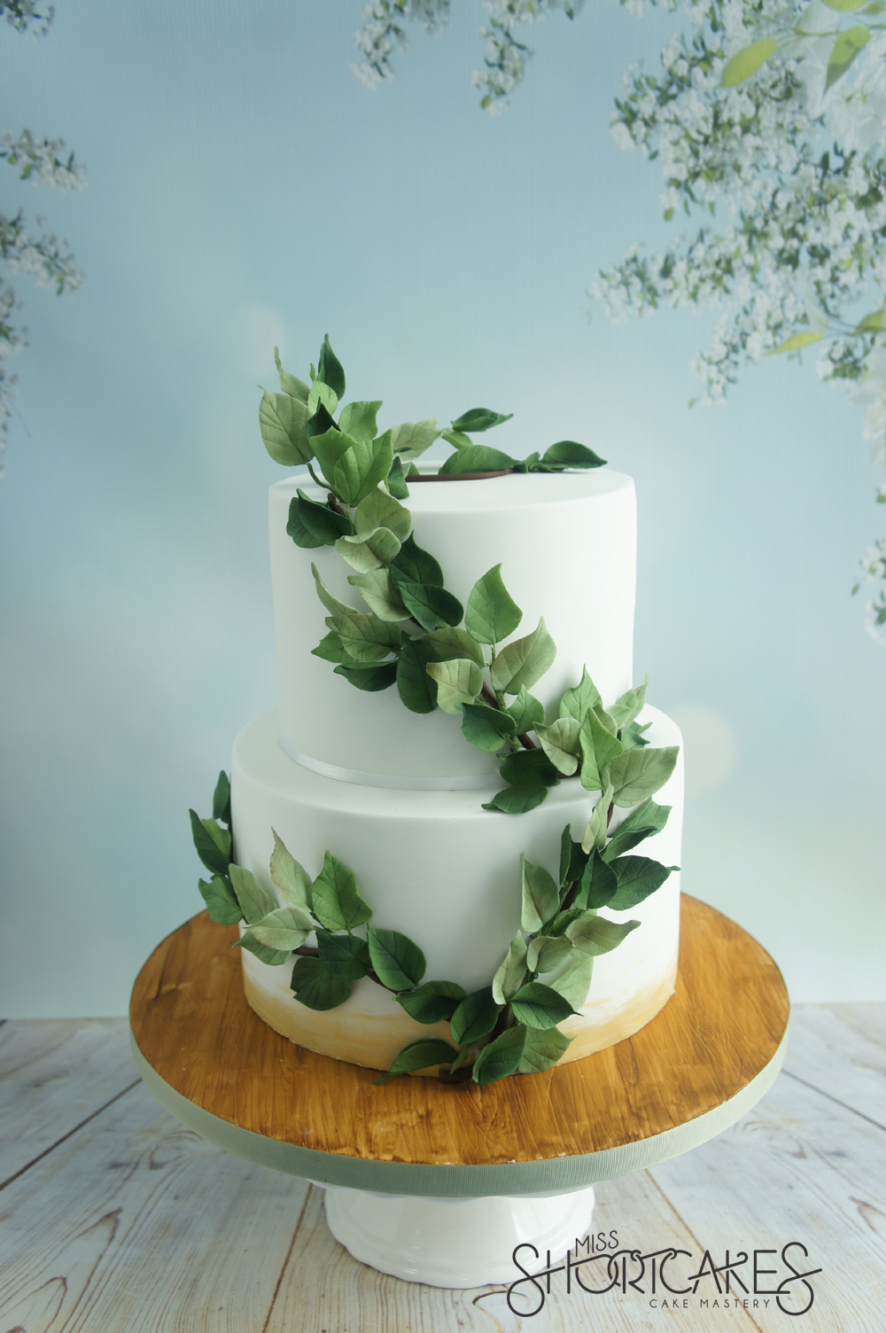 wedding cake with green leaves green 26903